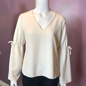 Cooper & Ella V-Neck Woven Top with Bell Sleeves